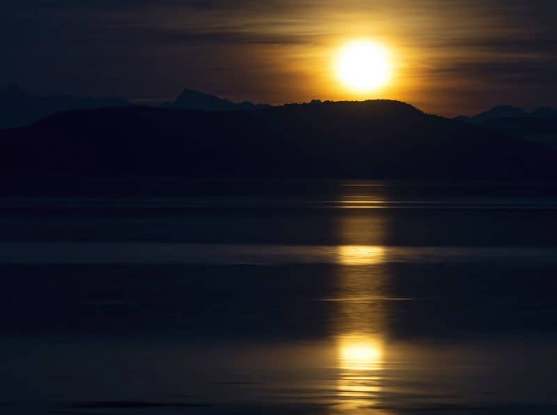 Moon Rising Over The Salish Sea by  Rick Leche