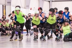 Roller Derby Action by  Carol Jackson